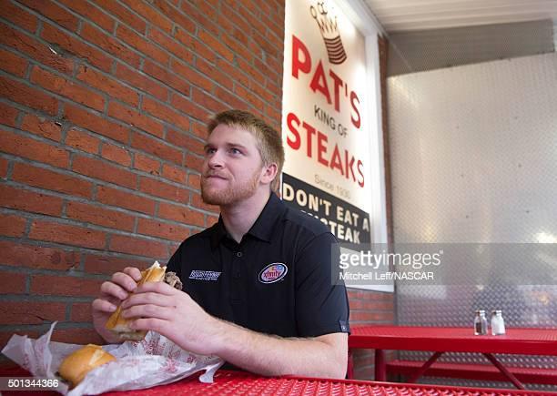 Chris Buescher eats a cheesesteak at Pat's King of Steaks on December 14 2015 in Philadelphia Pennsylvania