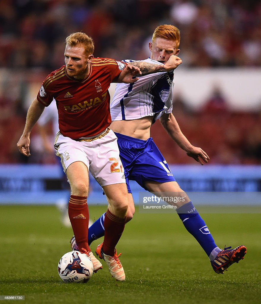 Chris Burke of Nottingham Forest battles with Reece Flanagan of Walsall during the Capital One Cup First Round match between Nottingham Forest and Walsall at City Ground on August 11, 2015 in Nottingham, England.