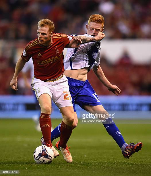 Chris Burke of Nottingham Forest battles with Reece Flanagan of Walsall during the Capital One Cup First Round match between Nottingham Forest and...