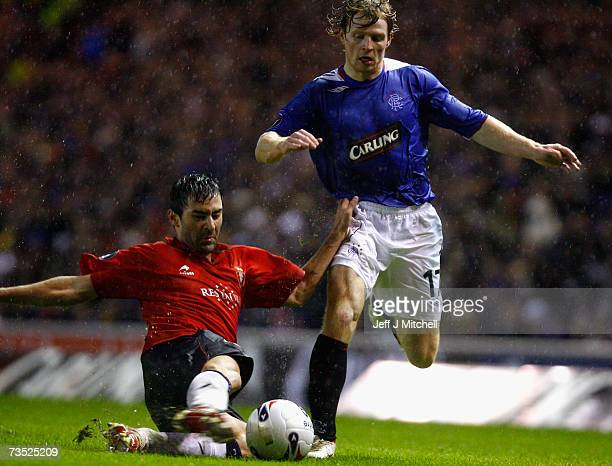 Chris Burke of Rangers tackles Raul Garcia of Osasuna during the UEFA Cup last 16 first leg match between Rangers and Osasuna at Ibrox Stadium March...