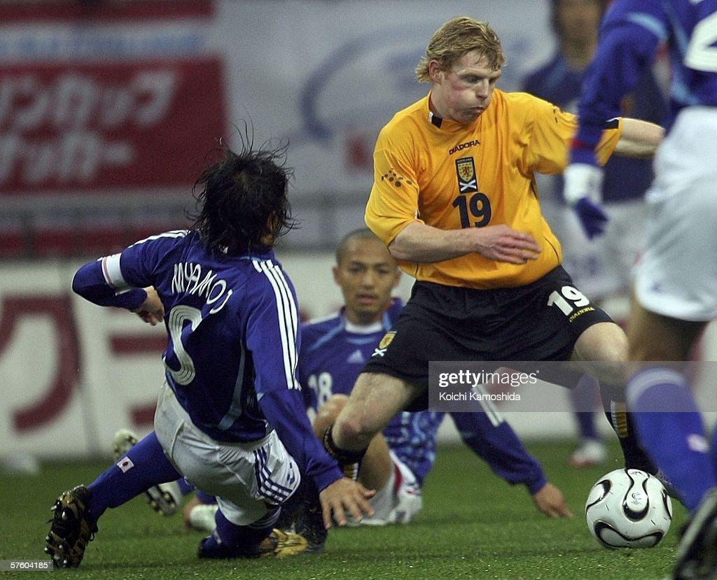 Chris Burke of Scotland and Tsuneyasu Miyamoto of Japan battle for the ball during the Kirin Cup Soccer 2006 between Scotland and Japan at the Saitama stadium on May 13, 2006 in Saitama, Japan.