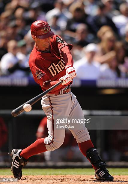 Chris Burke of the Arizona Diamondbacks takes a swing at a pitch during the MLB game against the Colorado Rockies at Coors Field on April 6 2008 in...