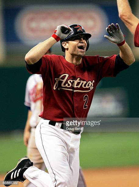 Chris Burke of the Houston Astros celebrates after hitting a solo home run to defeat the Atlanta Braves in Game Four of the 2005 National League...
