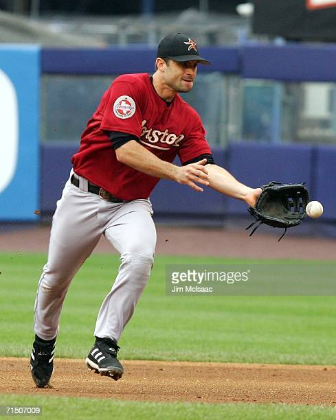 Chris Burke of the Houston Astros fields a ball against the New York Mets on July 23 2006 at Shea Stadium in the Flushing neighborhood of the Queens...