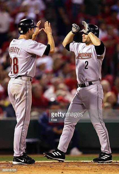 Chris Burke of the Houston Astros is congratulated by Adam Everett after Burke hit a pinchhit two run home run in the seventh inning against the St...