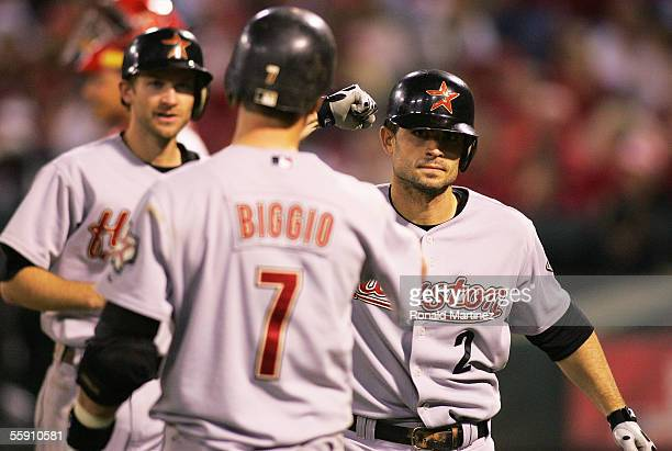 Chris Burke of the Houston Astros is congratulated by Craig Biggio and Adam Everett after Burke hit a pinchhit tworun home run in the seventh inning...