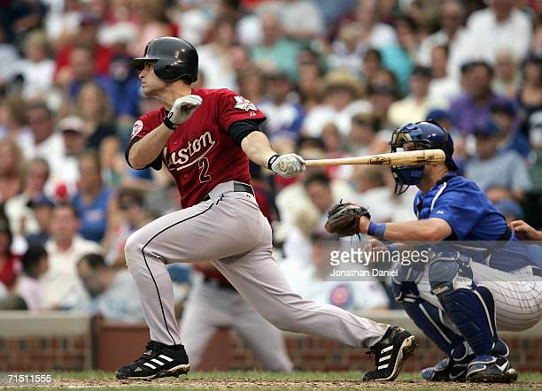 Chris Burke of the Houston Astros swings at the pitch during the game against the Chicago Cubs on July 20 2006 at Wrigley Field in Chicago Illinois