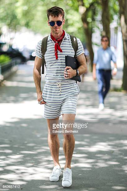Chris BurtAllan is wearing an Autonomy striped shirt an Autonomy striped short sunglasses a Coba clutch and Adidas white shoes before the Issey...