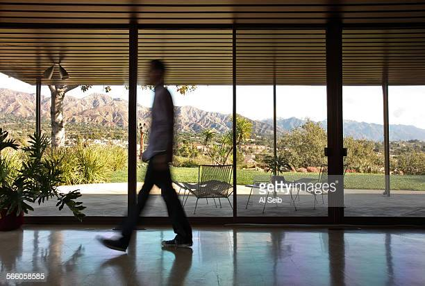 Chris Burusco walks through his 1950's home in Glendale The attorney and enthusiast of modern design owns what is known as the Daily house named...