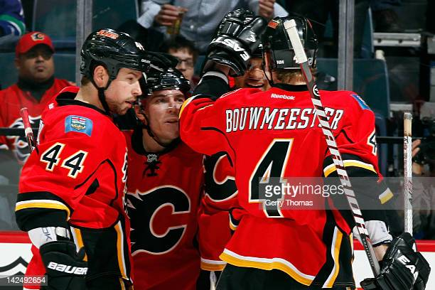 Chris Butler Michael Cammalleri Akim Aliu and Jay Bouwmeester of the Calgary Flames celebrate a goal against Vancouver Canucks on April 5 2012 at the...