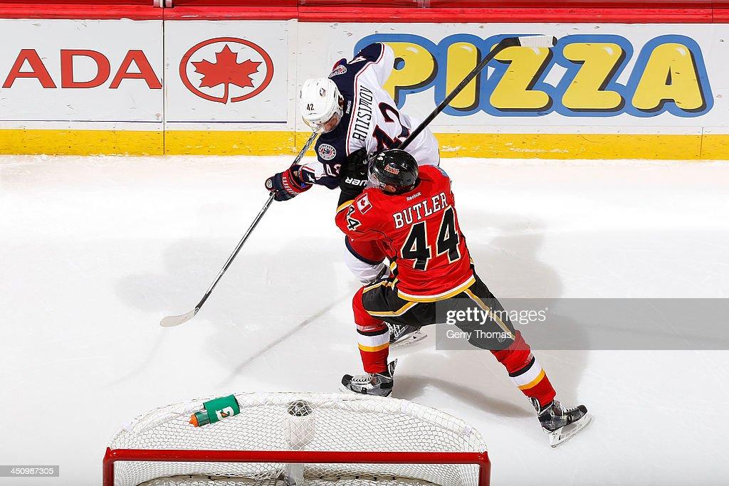 Chris Butler #44 of the Calgary Flames skates against Artem Anisimov #42 of the Columbus Blue Jackets at Scotiabank Saddledome on November 20, 2013 in Calgary, Alberta, Canada.