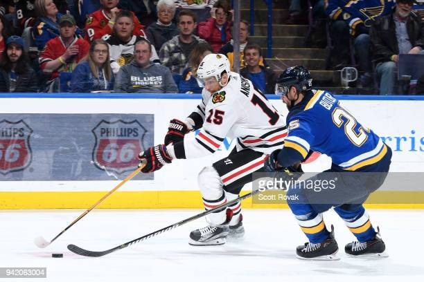 Chris Butler of the St Louis Blues defends against Artem Anisimov of the Chicago Blackhawks at Scottrade Center on April 4 2018 in St Louis Missouri
