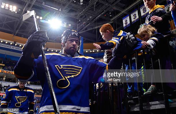 Chris Butler of the St Louis Blues high fives fans before a game against the Nashville Predators on January 29 2015 at Scottrade Center in St Louis...