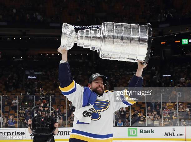Chris Butler of the St Louis Blues holds the Stanley Cup following the Blues victory over the Boston Bruins at TD Garden on June 12 2019 in Boston...