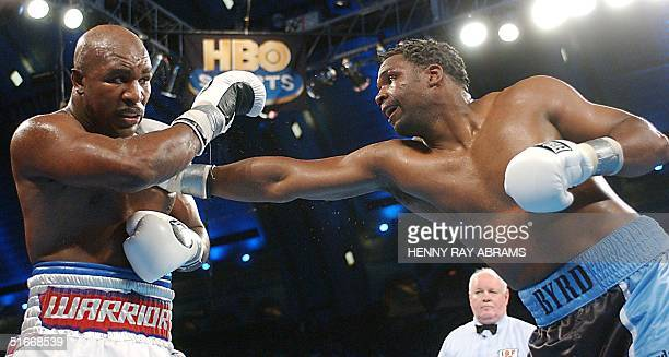 Chris Byrd lands a punch on Evander Holyfield during their IBF Heavyweight Championship bout 14 December, 2002 in Atlantic City, NJ. Byrd won the...
