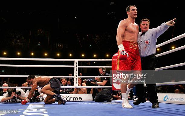 Chris Byrd of the USA lies on the mat after the second knock down by Wladimir Klitschko of Ukraine whilst Referee Wayne Kelly reacts during their IBF...