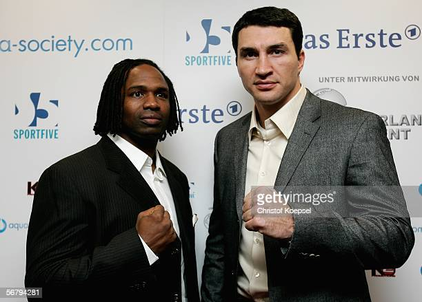 Chris Byrd of USA and Wladimir Klitschko of the Ukraine pose during a press conference ahead of the IBO/IBF heavyweight fight between Klitschko and...