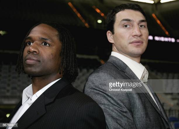 Chris Byrd of USA and Wladimir Klitschko stand back to back after a press conference ahead of the IBO/IBF heavyweight fight between Wladimir...