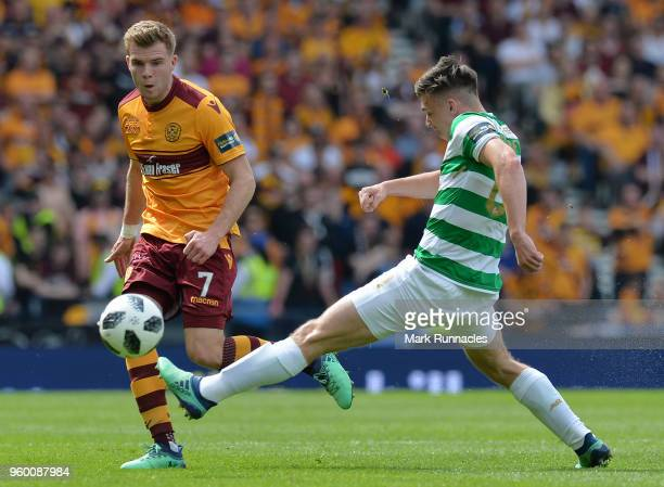 Chris Cadden of Motherwell passes the ball past Kieran Tierney of Celtic during the Scottish Cup Final between Motherwell and Celtic at Hampden Park...