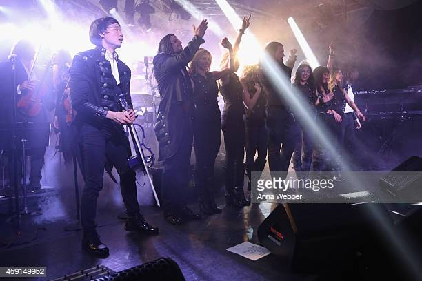 Chris Caffery Roddy Chong David Z Joel Hoekstra Derek Wieland and members of TransSiberian Orchestra take a bow onstage during an exclusive...