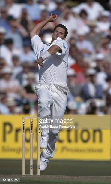 Chris Cairns bowling for New Zealand during the 3rd Test match between England and New Zealand at Old Trafford Manchester 5th August 1999