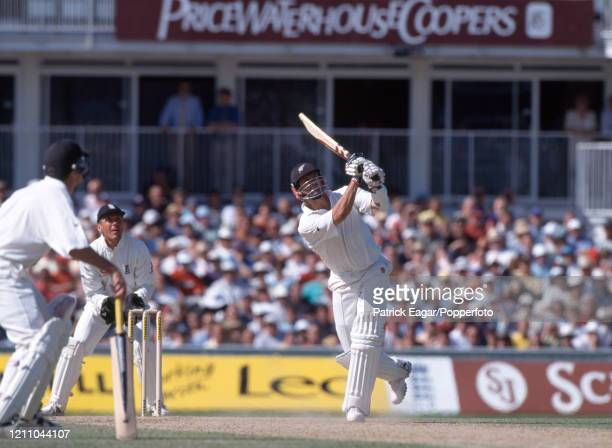 Chris Cairns of New Zealand hits Phil Tufnell of England for six during his innings of 80 runs in the 4th Test match between England and New Zealand...