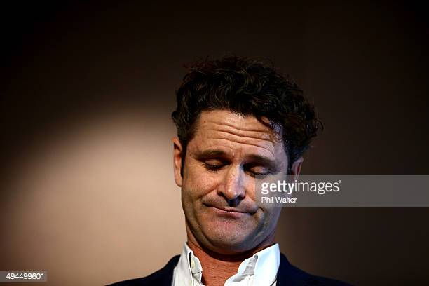 Chris Cairns reads a prepared statement to the media at a press conference at Auckland Airport on May 30 2014 in Auckland New Zealand Cairns has...
