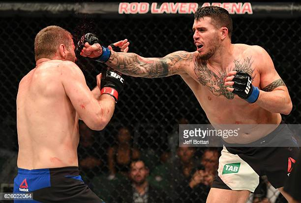 Chris Camozzi punches Daniel Kelly of Australia in their middleweight bout during the UFC Fight Night event at Rod Laver Arena on November 27 2016 in...
