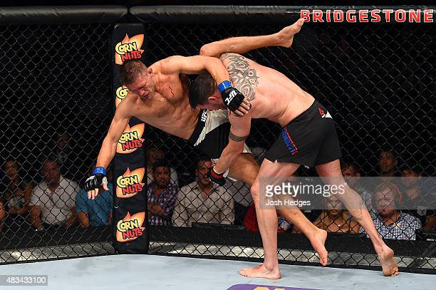 Chris Camozzi takes down Tom Watson of England in their middleweight bout during the UFC Fight Night event at Bridgestone Arena on August 8 2015 in...