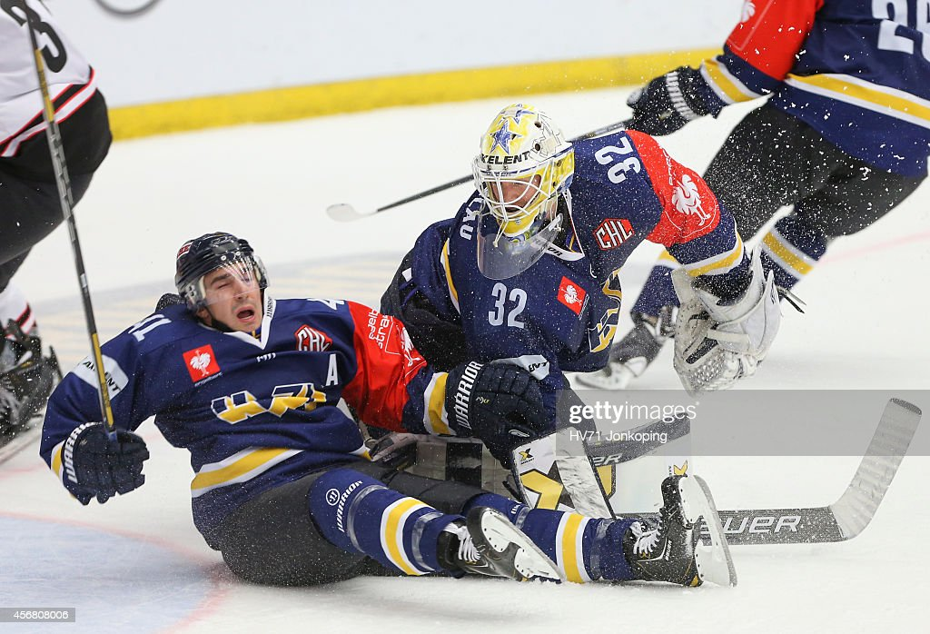 Chris Campoli #41 of HV71 collides with Gustaf Wesslau #32 Goaltender of HV71 during the Champions Hockey League group stage game between HV71 Jonkoping and JYP Jyvaskyla on October 7, 2014 in Jonkoping, Sweden.