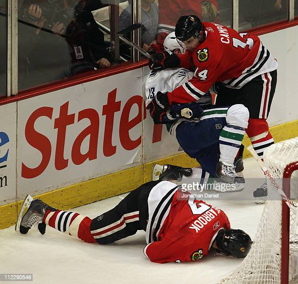 Chris Campoli of the Chicago Blackhawks hits Raffi Torres of the Vancouver Canucks after Torres knocked down Brent Seabrook with a hit behind the net...