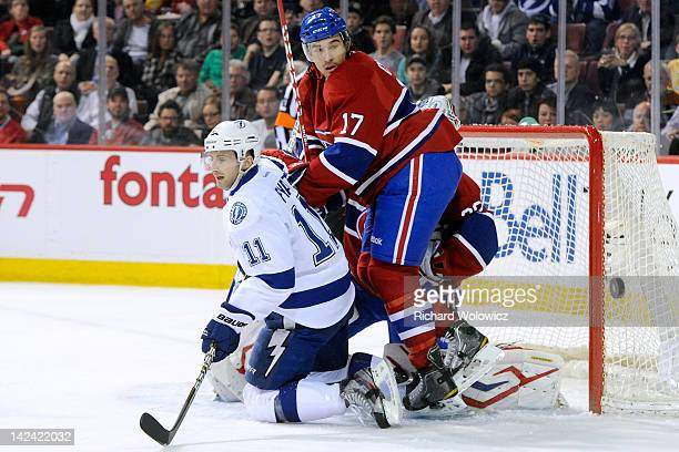 Chris Campoli of the Montreal Canadiens watches the rebounding puck in front of Tom Pyatt of the Tampa Bay Lightning during the NHL game at the Bell...
