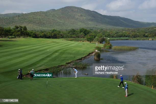 Chris Cannon of England plays his chip shot on the eighth hole during Day One of the South African Open at Gary Player CC on December 03, 2020 in Sun...