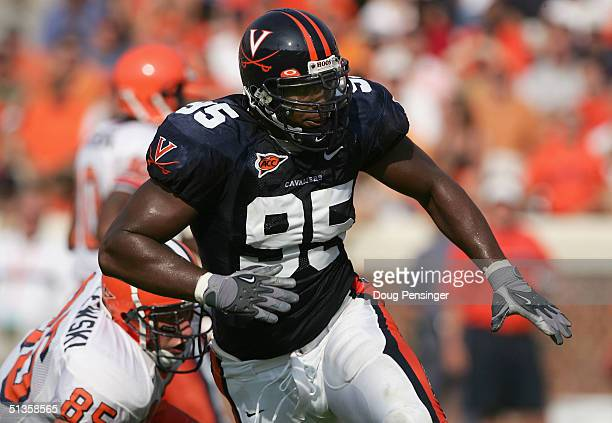 Chris Canty of the Virginia Cavaliers looks to make a tackle against the Syracuse Orangemen as the Cavaliers defeated the Orangemen 31-10 at Scott...
