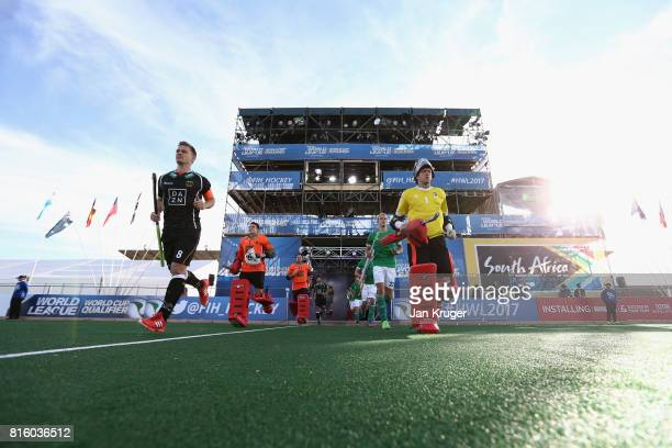 Chris Cargo of Ireland and Mark Appel of Germany leads their teams out prior to the Group B match between Germany and Ireland on day five of the FIH...