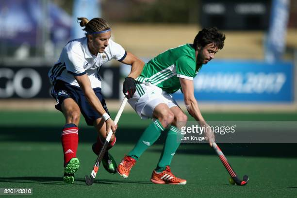 Chris Cargo of Ireland and Nicolas Dumont of France battle for possession during the 5th8th place play off match between Ireland and France on Day 7...