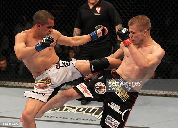 Chris Cariaso and Michael McDonald trade kicks during their bantamweight fight at UFC 130 at the MGM Grand Garden Arena on May 28, 2011 in Las Vegas,...