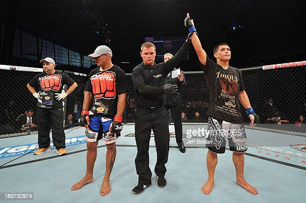 Chris Cariaso celebrates after defeating Iliarde Santos in their flyweight bout during the UFC Fight Night event at the Ginasio Jose Correa on...