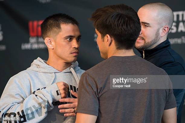 Chris Cariaso faces off with Henry Cejudo during the UFC 185 Ultimate Media Day at the American Airlines Center on March 12 2015 in Dallas Texas
