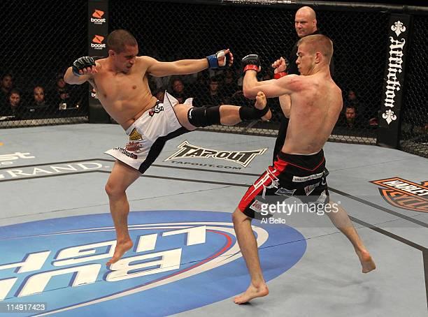 Chris Cariaso kicks Michael McDonald during their bantamweight fight at UFC 130 at the MGM Grand Garden Arena on May 28, 2011 in Las Vegas, Nevada.