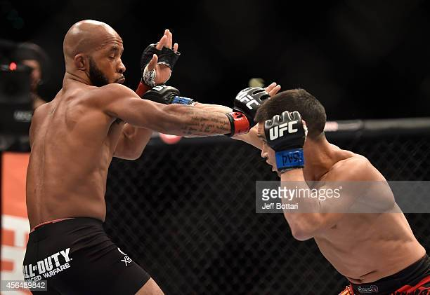 Chris Cariaso punches Demetrious Johnson in their flyweight bout during the UFC 178 event on September 27 2014 in Las Vegas Nevada