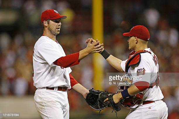 Chris Carpenter of St Louis is congratulated by catcher Yadier Molina after throwing a 2hit shutout against the Los Angeles Dodgers and St Louis...