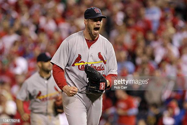 Chris Carpenter of the St Louis Cardinals reacts after he caught a line drive hit by Jimmy Rollins of the Philadelphia Phillies for the final out in...