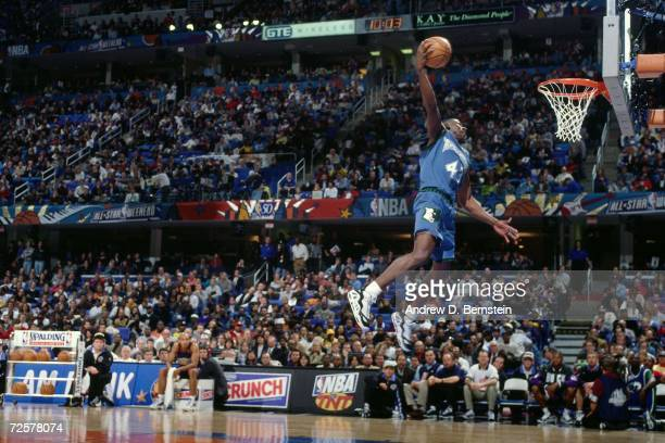 Chris Carr of the Minnesota Timberwolves soars for a dunk during the 1997 Nestle Crunch Slam Dunk Contest on February 8 1997 at the Gund Arena in...