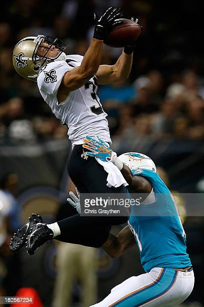 Chris Carr of the New Orleans Saints intercepts a pass intended for Mike Wallace of the Miami Dolphins at the MercedesBenz Superdome on September 30...