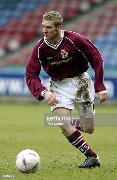 Chris Carruthers of Northampton Town runs with the ball during the Nationwide League Division Two match between Huddersfield Town and Northampton...