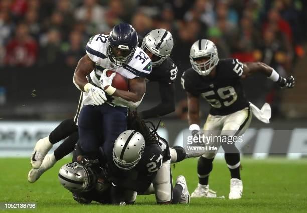 Chris Carson of Seattle Seahawks in action during the NFL International Series game between Seattle Seahawks and Oakland Raiders at Wembley Stadium...