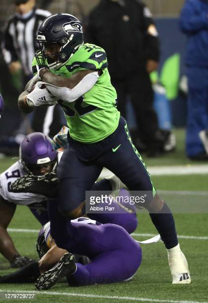 Chris Carson of the Seattle Seahawks breaks for a touchdown against the Minnesota Vikings during the third quarter at CenturyLink Field on October...