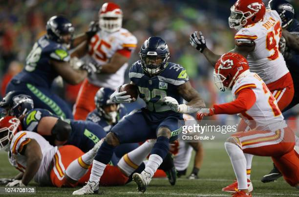Chris Carson of the Seattle Seahawks carries the ball against the Kansas City Chiefs during the fourth quarter of the game at CenturyLink Field on...