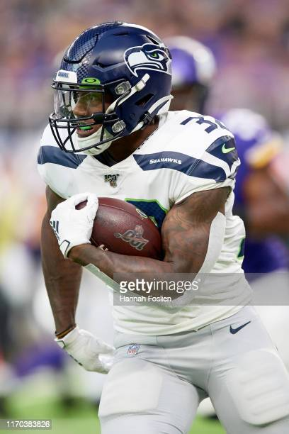 Chris Carson of the Seattle Seahawks carries the ball against the Minnesota Vikings during the preseason game at U.S. Bank Stadium on August 18, 2019...